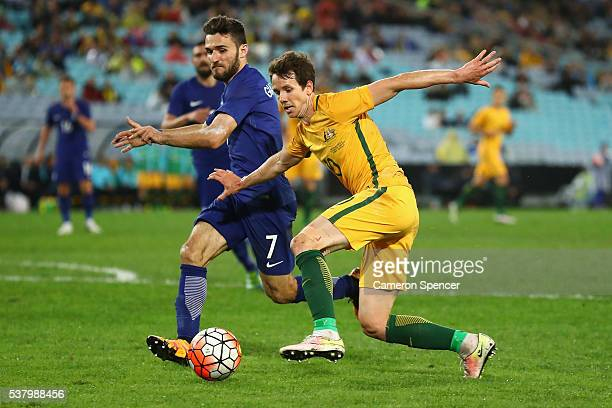 Ioannis Giaaniotas of Greece contests the ball with Robbie Kruse of the Socceroos during the international friendly match between the Australian...