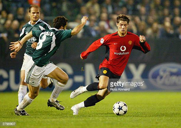 Ioannis Goumas of Panathinaikos chases Cristiano Ronaldo of Manchester United during the UEFA Champions League Group E match between Panathinaikos...