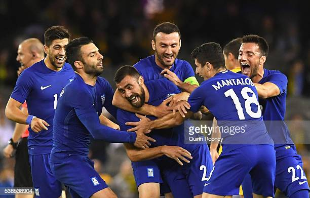 Ioannis Maniatis of Greece is congratulated by team mates after scoring a goal during the International Friendly match between the Australian...