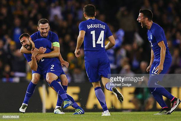 Ioannis Maniatis of Greece is hugged as he celebrates a goal during the International Friendly match between the Australian Socceroos and Greece at...