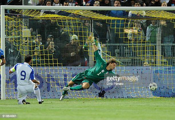 Ioannis Okkas of Cyprus scores the first goal during the FIFA2010 World Cup Group 8 Qualifier match between Italy and Cyprus at the Tardini Stadium...