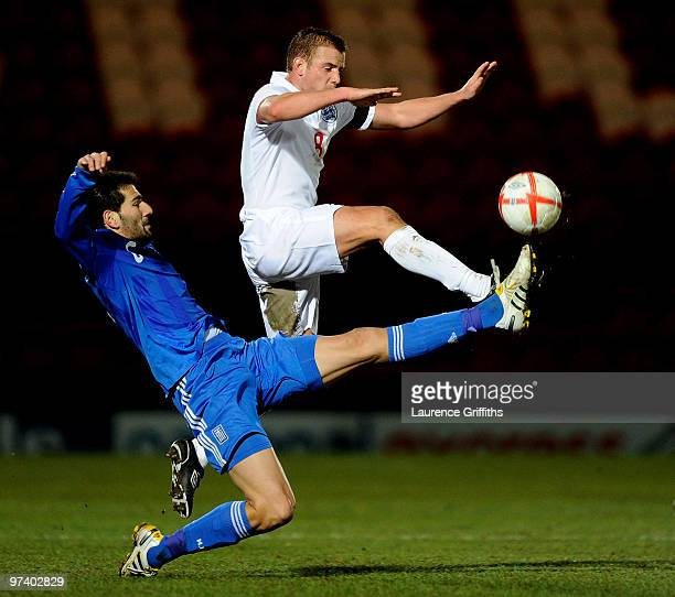 Ioannis Papadopoulos of Greece battles with Lee Cattermole of England during the UEFA Under 21 Championship Qualifying match between England and...