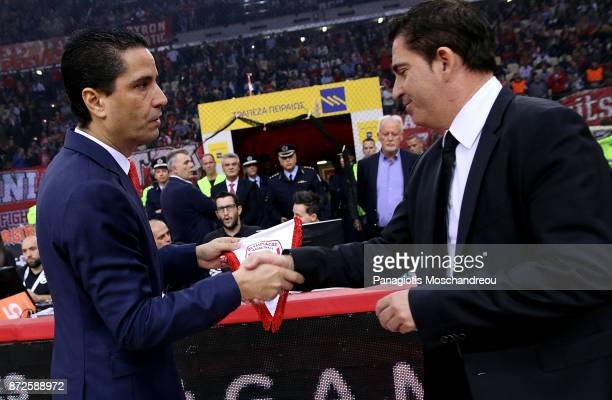 Ioannis Sfairopoulos Head Coach of Olympiacos Piraeus exchange handshake with Xavi Pascual Head Coach of Panathinaikos Superfoods Athens before the...