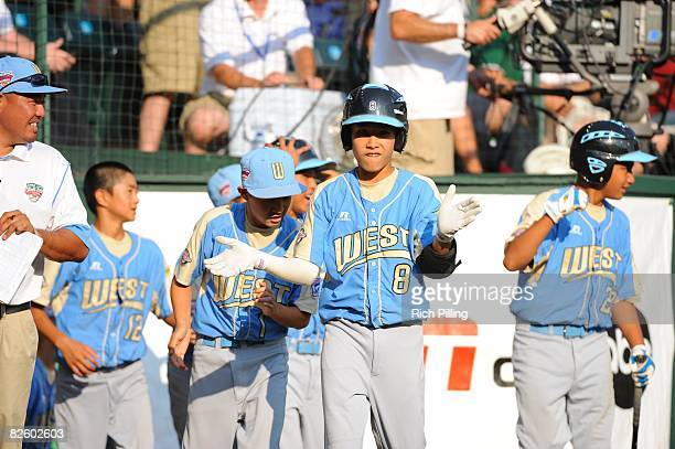 Iolana Akau of the Waipio Little League team celebrates during the World Series Championship game against the Matamoros Little League team at Lamade...