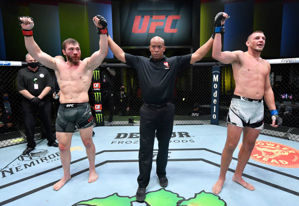 Ion Cutelaba of Moldova and Dustin Jacoby react after their light heavyweight bout was declared a draw during the UFC Fight Night event at UFC APEX...