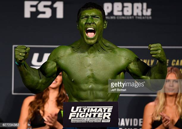 Ion Cutelaba steps onto the scale during the TUF Finale weigh-in in the Palms Resort & Casino on December 2, 2016 in Las Vegas, Nevada.