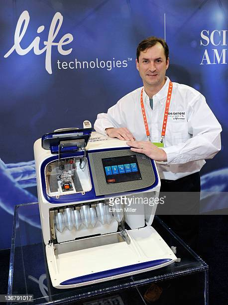 Ion Torrent Systems Inc Software Group Leader East Coast Mel Davey appears with the Proton Semiconductor Sequencer from Ion Torrent a new DNA...