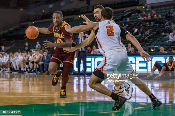 Iona Gaels guard Rickey McGill drives to the basket during the second half of the college basketball game between the Iona Gaels and Princeton Tigers...