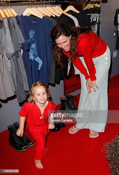 Ione Skye and daughter Goldie Priya Lee attend the Kelly Cole Store Grand Opening on July 26 2012 in Los Angeles California