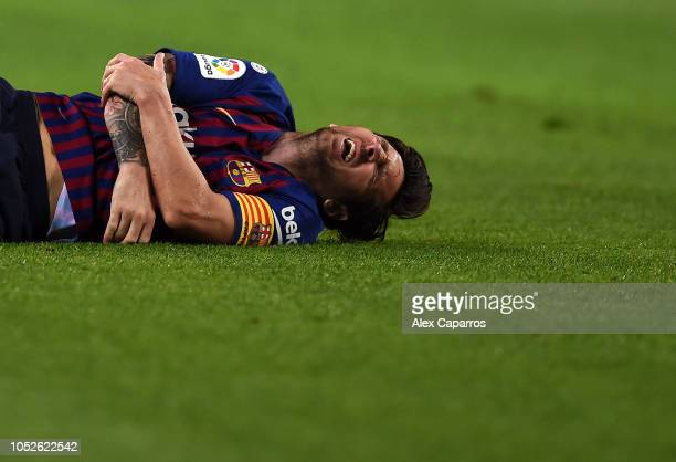 ionel Messi of FC Barcelona lies on the floor in pain after appearing to pick up an injury during the La Liga match between FC Barcelona and Sevilla...