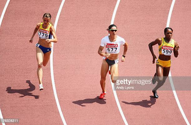Ionela TarleaManolache of Romania Ana Guevara of Mexico and Novlene Williams of Jamaica compete during the Women's 400m heats on day two of the 11th...