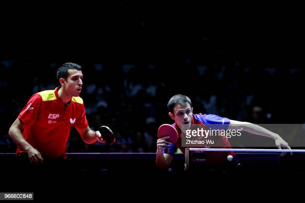 Ionescu Ovidiu of Romania and Robles Alvaro of Spain in action at the men's doubles final compete with Fan Zhendong and Lin Gaoyuan of China during...