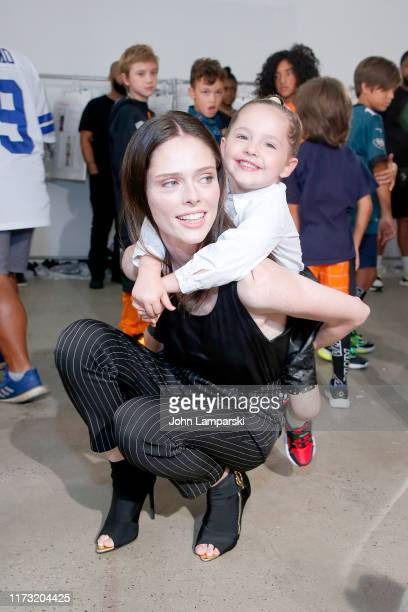 Ioni James Conran and Coco Rocha prepare backstage for China Day Anta Kids during New York Fashion Week The Shows on September 08 2019 in New York...
