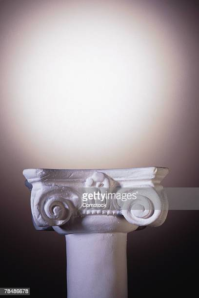 Ionic pedestal and spotlight