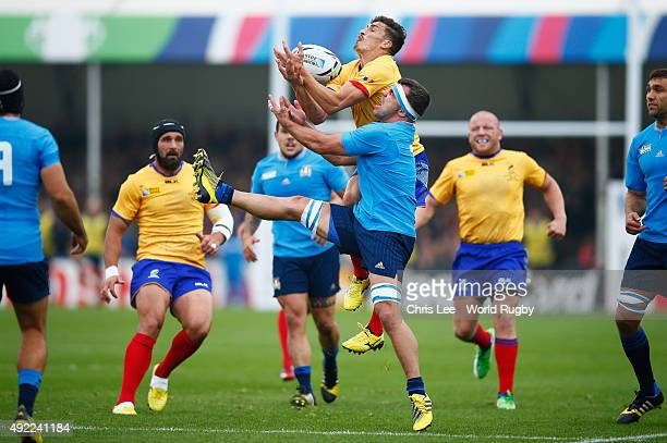 Ionut Botezatu of Romania and Simone Favaro of Italy compete for the ball during the 2015 Rugby World Cup Pool D match between Italy and Romania at...