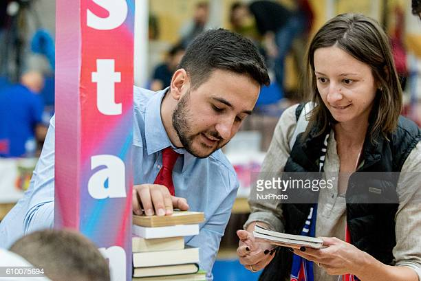 Ionut Georgescu the general manager of Steaua CSM EximBank Bucharest and Ana Maria Popescu placing a book in the campaign quotstands tall Readingquot...