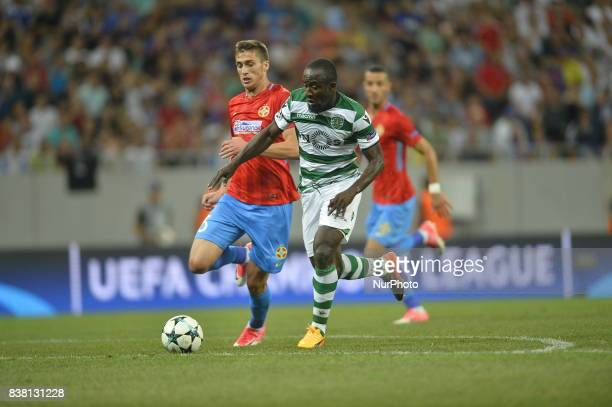 Ionut Larie Steaua vs Seydou Doumbia of Sporting during the UEFA Champions League playoffs 2nd leg football match between FC Steaua Bucharest and...