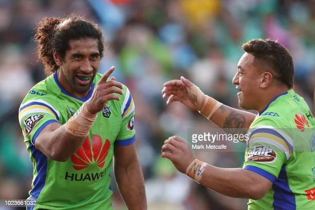 Iosia Soliola of the Raiders celebrates scoring a try with team mate Josh Papalii of the Raiders during the round 24 NRL match between the Canberra...