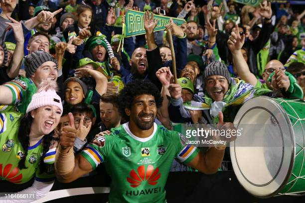 Iosia Soliola of the Raiders celebrates victory with fans at the end of the round 19 NRL match between the Panthers and Raiders at Panthers Stadium...