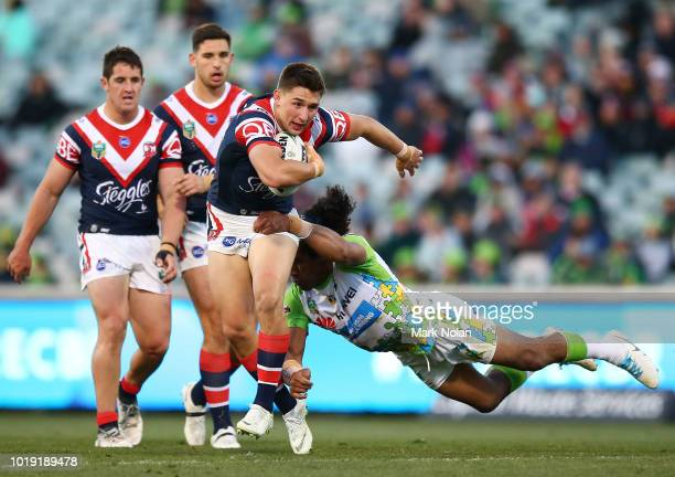 Iosia Soliola of the Raiders dives to tackle Victor Radley of the Roosters during the round 23 NRL match between the Canberra Raiders and the Sydney...