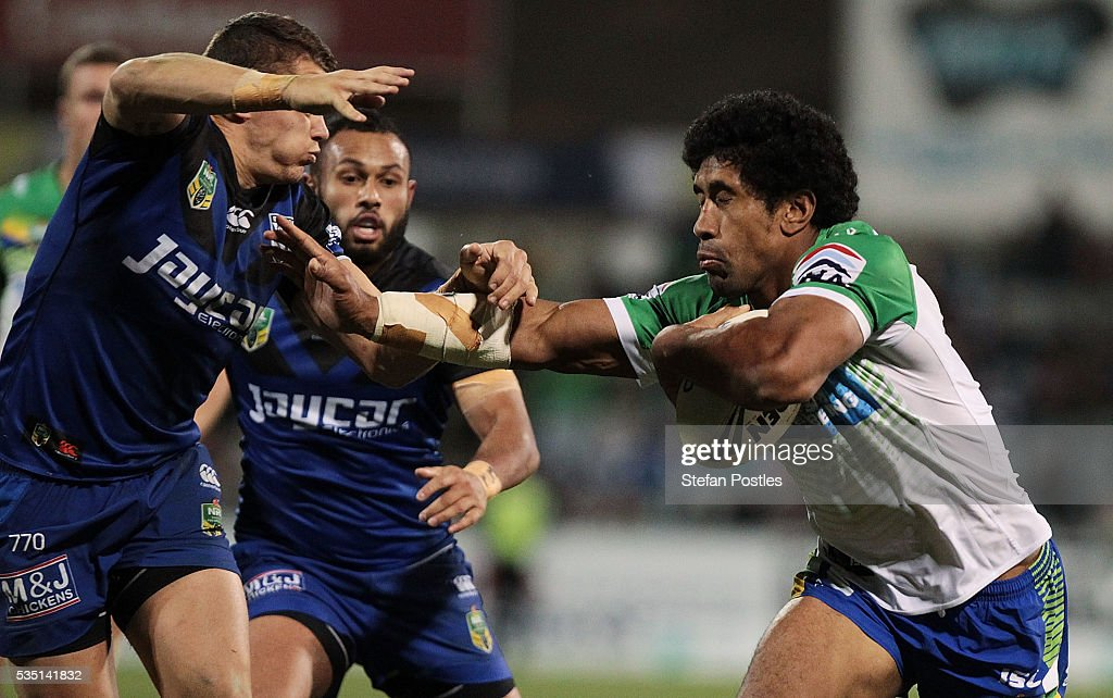 Iosia Soliola of the Raiders is tackled during the round 12 NRL match between the Canberra Raiders and the Canterbury Bulldogs at GIO Stadium on May 29, 2016 in Canberra, Australia.