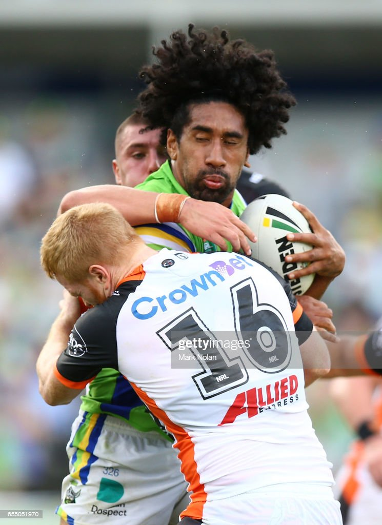 Iosia Soliola of the Raiders is tackled during the round three NRL match between the Canberra Raiders and the Wests Tigers at GIO Stadium on March 19, 2017 in Canberra, Australia.