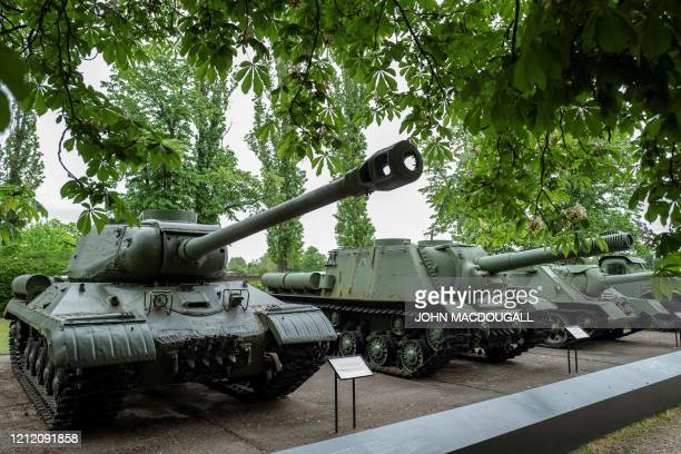 A Iosip Stalin heavy battle tank and an ISU 152 selfpropelled gun carriage are on display outside the GermanRussian museum in the Berlin district of...