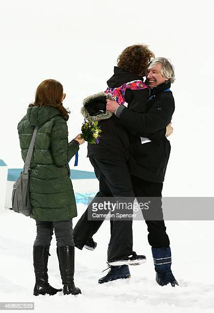 Iouri Podladtchikov of Switzerland celebrates with family after the Snowboard Men's Halfpipe Finals on day four of the Sochi 2014 Winter Olympics at...
