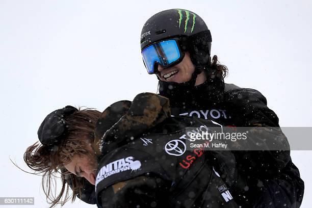 Iouri Podladtchikov of Switzerland congratulates Patrick Burgener of Switzerland after his last run in the final round of the FIS Snowboard World Cup...
