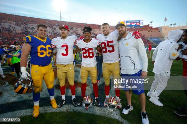 Iowa alumni Austin Blythe of the Los Angeles Rams along with CJ Beathard Greg Mabin and George Kittle of the San Francisco 49ers gather on the field...
