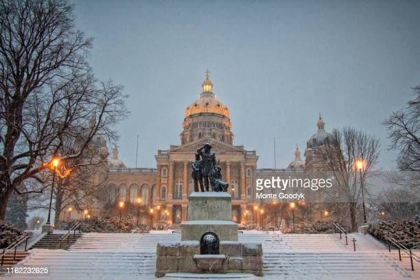 iowa capitol in evening snowfall - iowa stock pictures, royalty-free photos & images