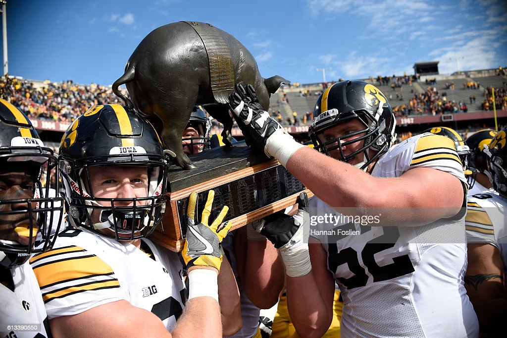 Iowa celebrate a win of the game against Minnesota with Floyd of Rosedale Trophy on October 8, 2016 at TCF Bank Stadium in Minneapolis, Minnesota. Iowa defeated Minnesota 14-7.