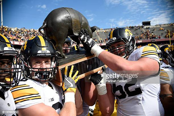 Iowa celebrate a win of the game against Minnesota with Floyd of Rosedale Trophy on October 8, 2016 at TCF Bank Stadium in Minneapolis, Minnesota....