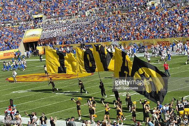 Iowa cheerleaders lead the team onto the field prior to the first half of the Outback Bowl game between the Florida Gators and the Iowa Hawkeyes on...