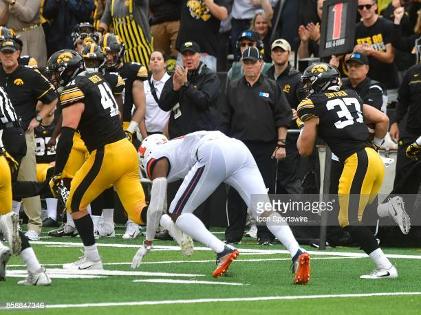 Iowa defensive back Brandon Snyder return an interception 89 yards for a score during a Big Ten Conference football game between the Illinois...
