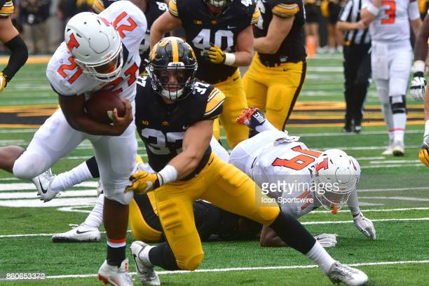 Iowa defensive back Brandon Snyder tackles Illinois running back Ra'Von Bonner during a Big Ten Conference football game between the Illinois...