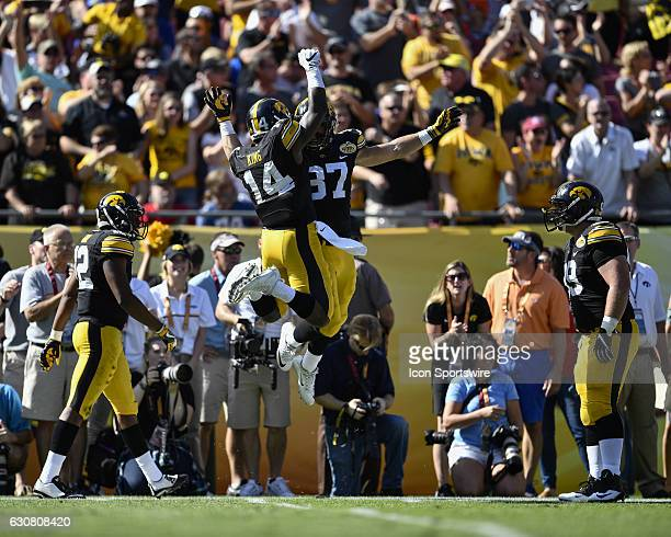 Iowa defensive back Desmond King celebrates his interception with Iowa defensive back Brandon Snyder during the first half of the Outback Bowl game...