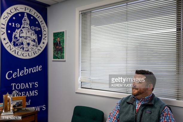 Iowa Democratic Party Chair Troy Price poses for pictures after an interview with AFP on January 30 2020 in Des Moines Iowa The Democrats hoping to...