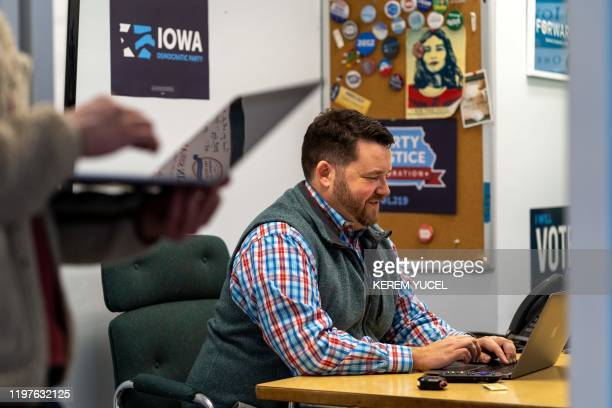 Iowa Democratic Party Chair Troy Price works in his office in Des Moines Iowa on January 30 2020 The Democrats hoping to clinch victory in the first...