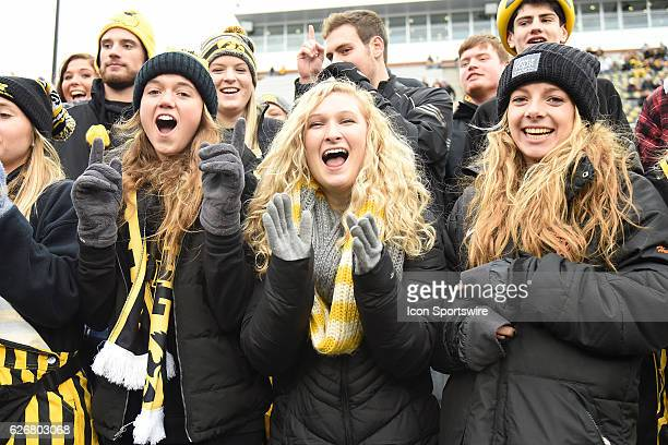 Iowa fans celebrate during a Big Ten Conference football game between the Nebraska Cornhuskers and the Iowa Hawkeyes on November 25 at Kinnick...