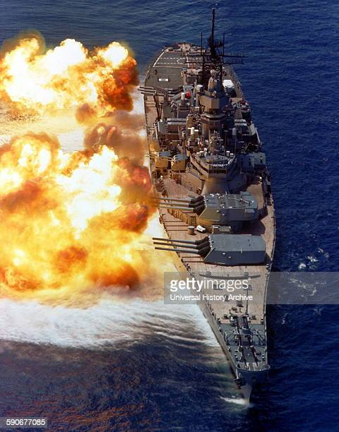 USS Iowa firing a full broadside during a gunnery demonstration 15 Aug 1984
