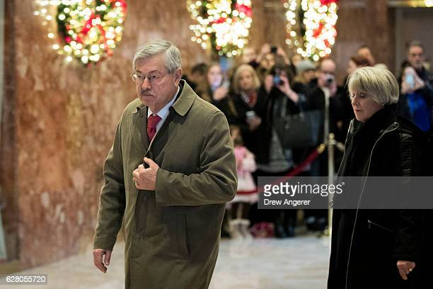 Iowa Gov Terry Branstad walks through the lobby at Trump Tower December 6 2016 in New York City Presidentelect Donald Trump and his transition team...