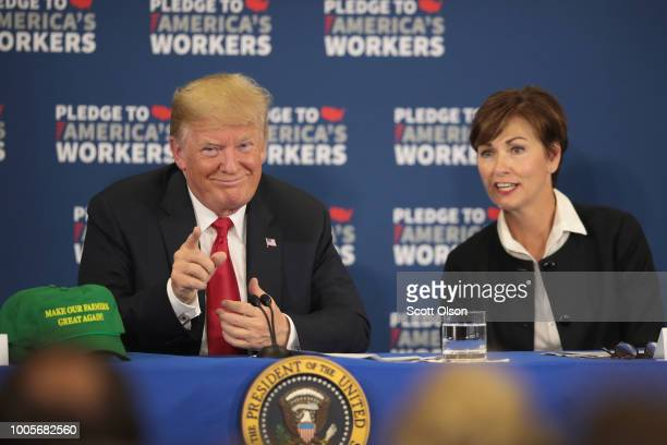 Iowa Governor Kim Reynolds and President Donald Trump participate in a round table at Northeast Iowa Community College on July 26 2018 in Peosta Iowa...