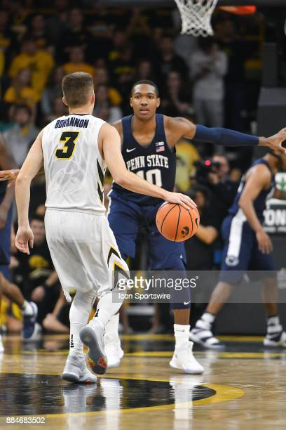 Iowa guard Jordan Bohannon brings the ball up court against Penn State guard Tony Carr during a Big Ten Conference basketball game between the Penn...