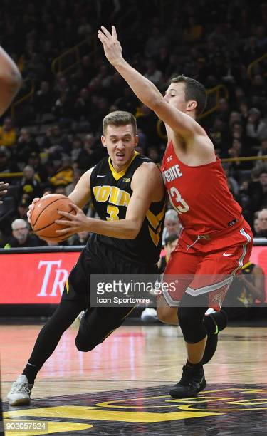 Iowa guard Jordan Bohannon drives to the basket around Ohio State guard Andrew Dakich during a Big Ten Conference basketball game between the Ohio...