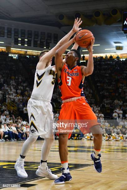 Iowa guard Jordan Bohannon tightly guards Illinois guard Te'Jon Lucas during a Big Ten Conference basketball game between the University of Illinois...