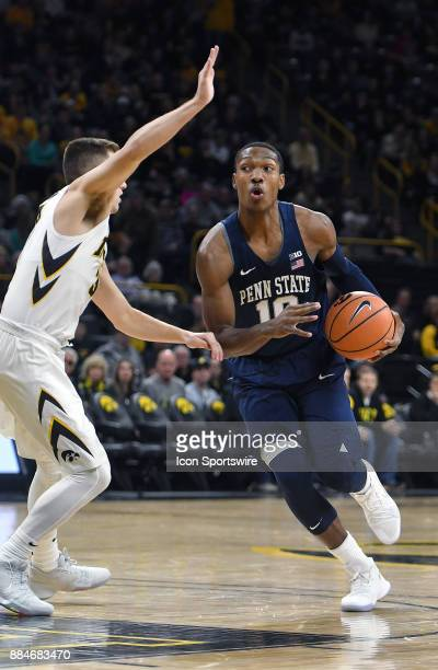 Iowa guard Jordan Bohannon tightly guards Penn State guard Tony Carr in the first half during a Big Ten Conference basketball game between the Penn...