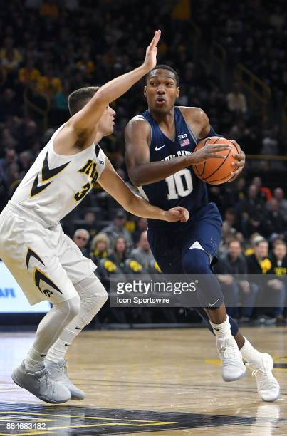 Iowa guard Jordan Bohannon tightly guards Penn State guard Tony Carr during a Big Ten Conference basketball game between the Penn State Nittany Lions...