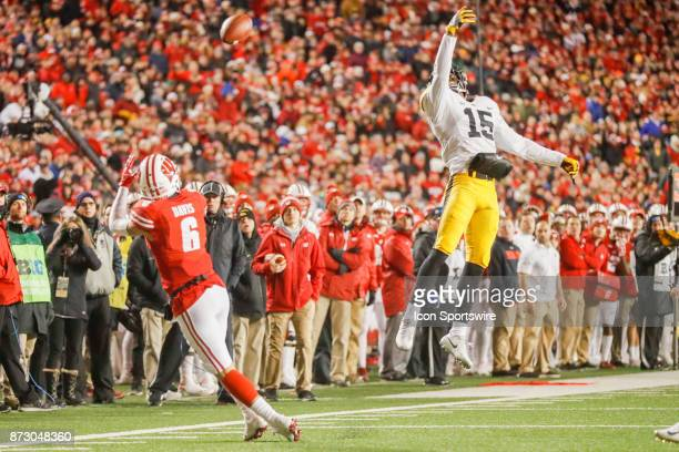 Iowa Hawkeye Defensive Back Josh Jackson can't keep Wisconsin Badger wide receiver Danny Davis III from making a reception at the 10 yard line during...