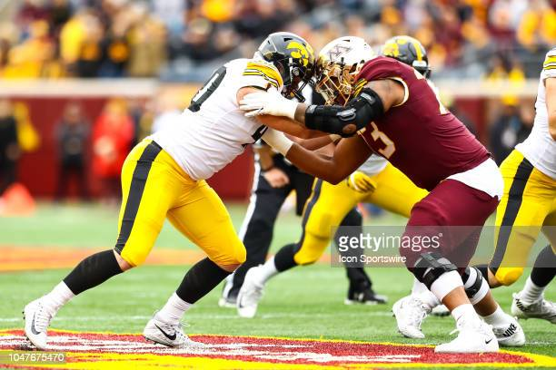 Iowa Hawkeyes defensive end Parker Hesse left and Minnesota Golden Gophers offensive lineman Donnell Greene collide during the Big Ten Conference...